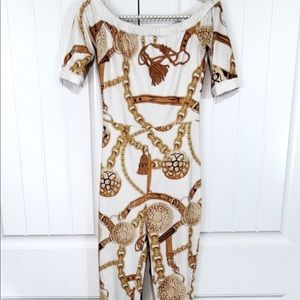 Banjul stretch jumpsuit, gold chain on white.